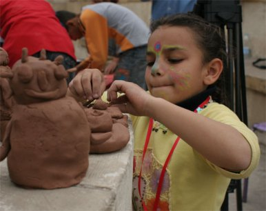 girl with clay