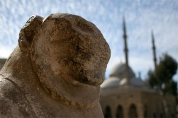 lion head with ali mosque in bg