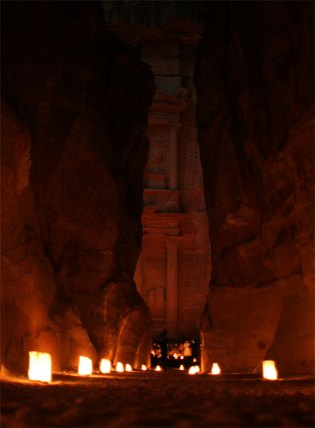 Petra Treasury through canyon at night