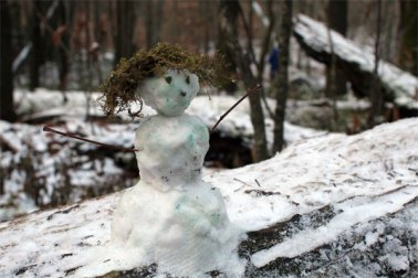 little snowman on log