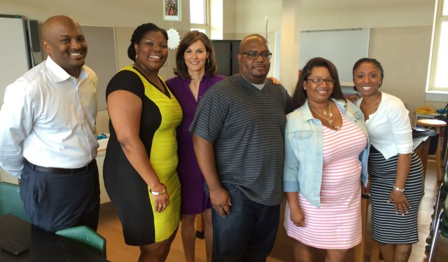 Campbell Brown (third from left) with Jamar McKneely (far left), the CEO of InspireNOLA charter schools, and parents of children at the Andrew Wilson school in Broadmoor.